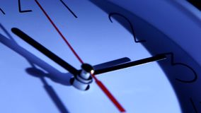 An image of a clock at twelve. Close up stock video footage