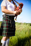 Image close up of man enjoying playing pipes in Royalty Free Stock Images