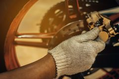 Image is Close up,People are repairing a motorcycle royalty free stock image