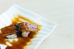 The image close up unagi sushi on white mood in japanese restau stock image