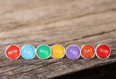 Image of Close up weekly push pins Royalty Free Stock Photography