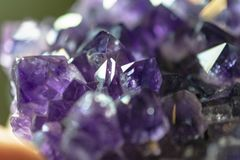 Purple Amethyst Crystal Cluster Gems. This image is a a closeup of an amethyst crystal. It was taken in February 2019. Purple crystal stock image