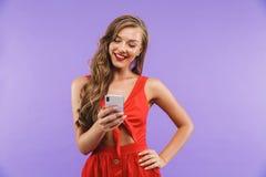 Image closeup of beautiful happy woman 20s wearing red dress smi Stock Image
