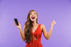 Image closeup of happy pretty woman 20s wearing red dress scream Stock Photography