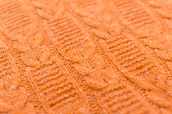 Image of closeup on orange beautiful knitted fabric pattern design Royalty Free Stock Images