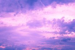 The image of clouds in the sky. Background of pink dramatic clouds in the dark sky before a thunderstorm Stock Photos