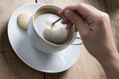 Image of a coffee cup being stirred Royalty Free Stock Photo