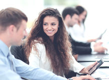 Image of collegues discussing documents and ideas at meeting in Royalty Free Stock Photography