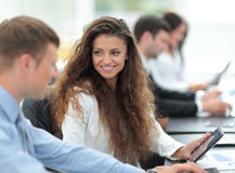 Image of collegues discussing documents and ideas at meeting in Royalty Free Stock Images