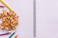 Image of color pencils on blank white book. Royalty Free Stock Photo
