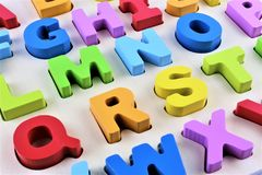 An Image of a colorful Alphabet toy. Wooden letter game - abstract Stock Photos