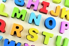 An Image of a colorful Alphabet toy. Wooden letter game - abstract Stock Photo