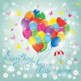 Image with colorful balloons in heart shape on sky blue Stock Photos