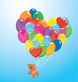 Image with colorful balloons in heart shape and teddy bear
