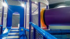 Image of colorful children playground with ladders, stairs and tubes for climbing covered with soft mats for kids safety. Photo of colorful children playground stock image