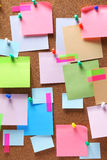 Image of colorful sticky notes on cork bulletin board. Image of colorful sticky notes and push pins on cork bulletin board Stock Photography