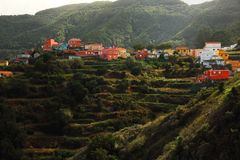 A peaceful village in the mountains of Tenerife. An image of a colorful village in the mountains of Tenerife with agricultural fields and terraces all around Royalty Free Stock Photo
