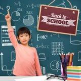 Image composée d'élève heureux avec la main augmentée Photo stock