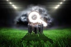 Image composée d'équipe d'affaires regardant l'appareil-photo Photos stock