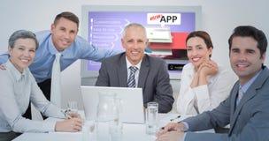 Image composée d'équipe d'affaires regardant l'appareil-photo photos libres de droits