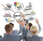 Image composée d'équipe d'affaires soulevant des mains pendant la conférence Photos stock