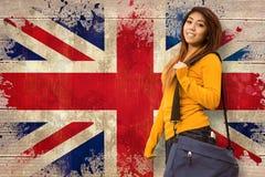 Image composée d'étudiant universitaire féminin avec le sac en parc Images libres de droits