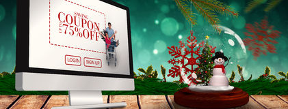 Image composée d'arbre de bonhomme de neige et de Noël en globe de neige Photos stock