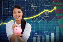 Image composée d'argent avec du charme d'économie de femme d'affaires dans une tirelire Photos stock
