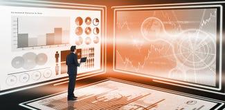 Image composée d'homme d'affaires bel se tenant utilisant un ordinateur portable Images libres de droits