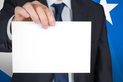 Image composée d'homme d'affaires mûr montrant la carte Photo libre de droits