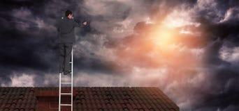 Image composée d'homme d'affaires se tenant sur l'échelle Images libres de droits