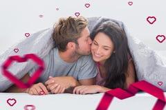 Image composée d'homme attirant embrassant son épouse Image libre de droits