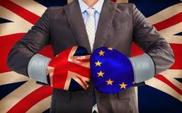 Image composée d'homme d'affaires avec des gants de boxe Photos libres de droits
