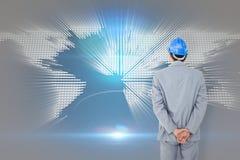 Image composée d'homme d'affaires avec le casque tournant le sien de nouveau à l'appareil-photo Photos libres de droits