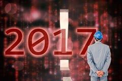 Image composée d'homme d'affaires avec le casque tournant le sien de nouveau à l'appareil-photo Images libres de droits