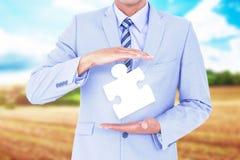 Image composée d'homme d'affaires bel faisant des gestes avec des mains Photographie stock