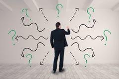 Image composée d'homme d'affaires dans l'écriture de costume avec le marqueur Image stock