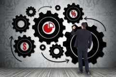 Image composée d'homme d'affaires dans l'écriture de costume avec le marqueur Image libre de droits