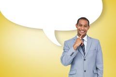 Image composée d'homme d'affaires de pensée avec la bulle de la parole Image stock