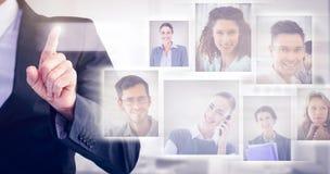 Image composée d'homme d'affaires dirigeant son doigt à l'appareil-photo Images stock