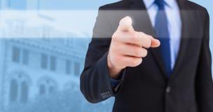 Image composée d'homme d'affaires dirigeant son doigt à l'appareil-photo image libre de droits