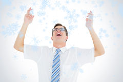 Image composée d'homme d'affaires heureux geeky avec des bras  Photographie stock