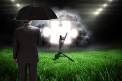 Image composée d'homme d'affaires montant l'échelle Photographie stock libre de droits