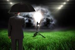 Image composée d'homme d'affaires montant l'échelle Photo libre de droits