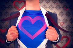 Image composée d'homme d'affaires ouvrant son style de super héros de chemise Photographie stock