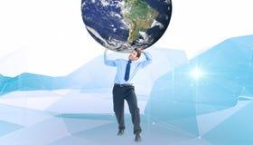 Image composée d'homme d'affaires portant le monde photos stock