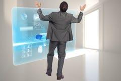 Image composée d'homme d'affaires posant avec des bras augmentés Photo stock