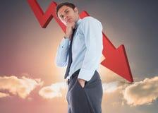 Image composée d'homme d'affaires réfléchi avec la main sur le menton Photographie stock libre de droits