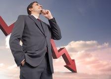 Image composée d'homme d'affaires réfléchi avec la main sur le menton Photographie stock