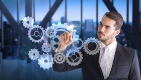 Image composée d'homme d'affaires réfléchi dirigeant quelque chose avec son doigt photos stock
